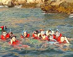 snorkel en el campamento de playa en murcia Aguilas. Verano julio y agosto